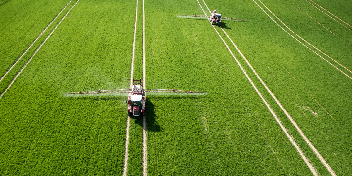 Aerial view of tractor pesticide spraying