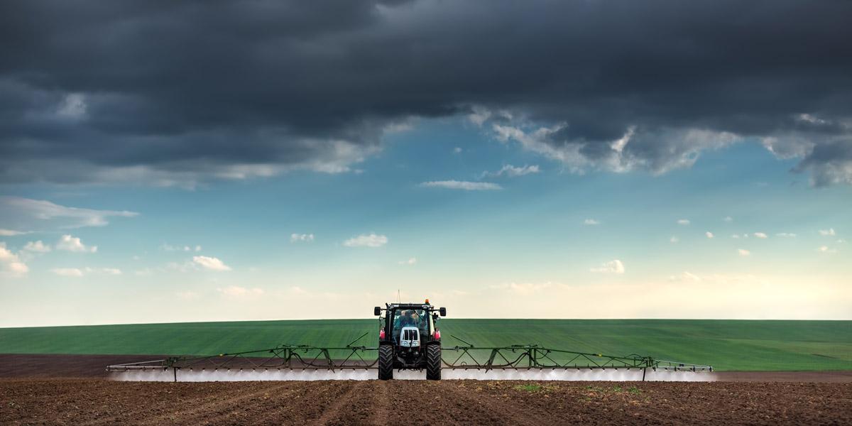 Tractor Spraying Roundup Glyphosate