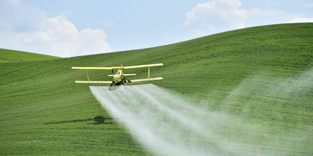 Biplane Crop Duster Spraying Glyphosate pesticide