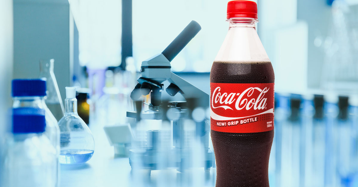 CocaCola bottle and medical equipment in laboratory
