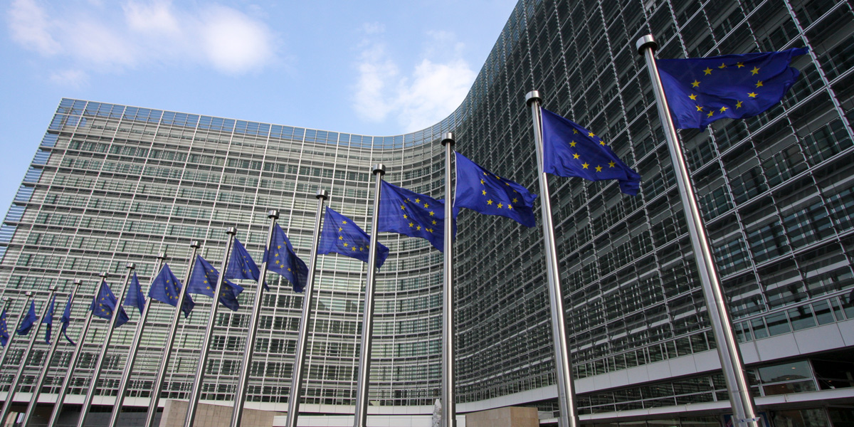 European Commission building with flags