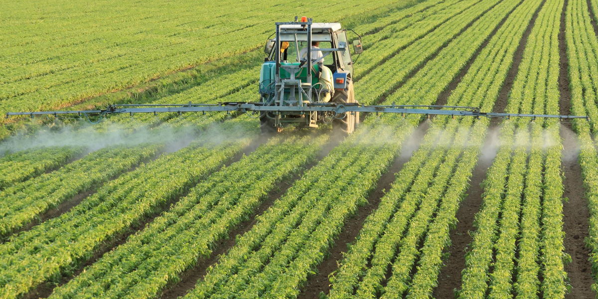 Farming tractor spraying glyphosate